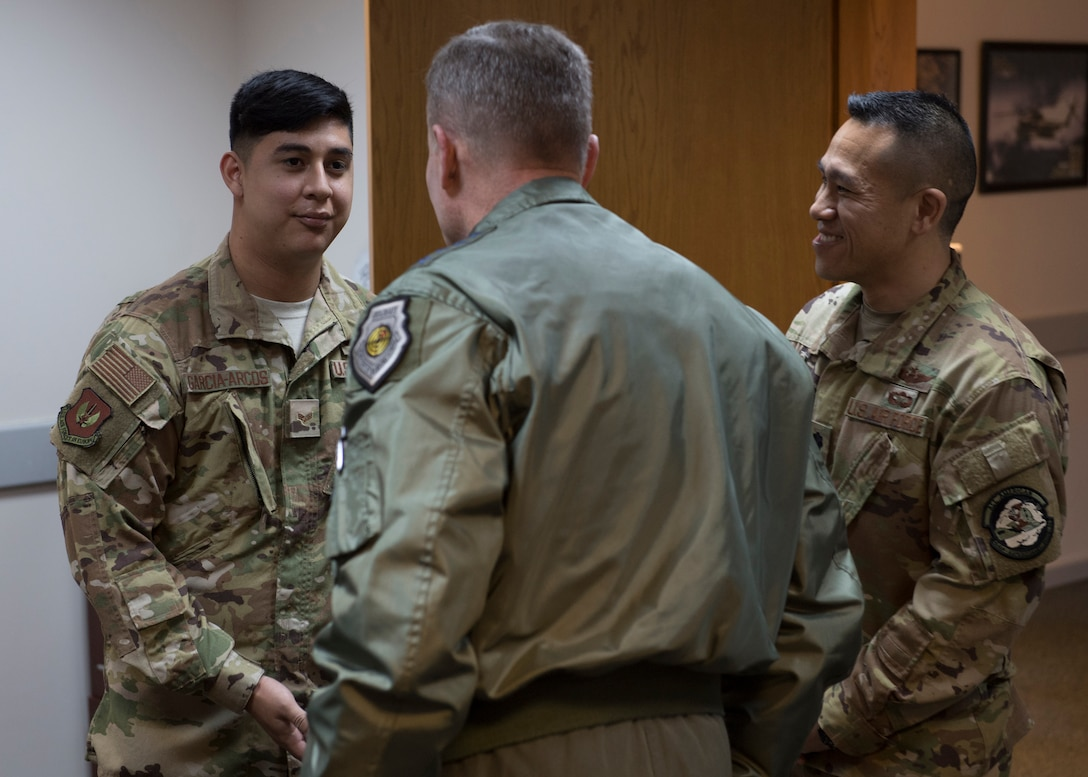 U.S. Air Force Senior Airman George Garcia-Arcos, 39th Air Base Wing service member, receives a coin from U.S. Air Force Gen. Tod D. Wolters, U.S. Air Forces in Europe-Air Forces Africa commander, before an all-call at Incirlik Air Base, Turkey, Dec. 6, 2018.