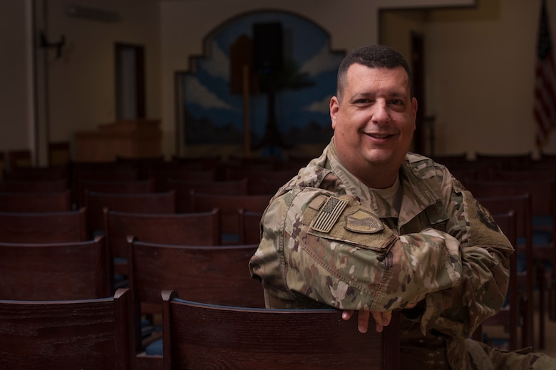 Chaplain (Maj.) Jack Miller, 379th Air Expeditionary Wing chaplain, sits in the Victory Chapel sanctuary Dec. 6, 2018, at Al Udeid Air Base, Qatar. Miller was diagnosed with adrenal cancer in 2012 and told by doctors that he would never run long distances again. While deployed at Al Udeid, Miller trained for months and was able to complete the base's Veterans Day 5K run Nov. 11, 2018. (U.S. Air Force photo by Tech. Sgt. Christopher Hubenthal)