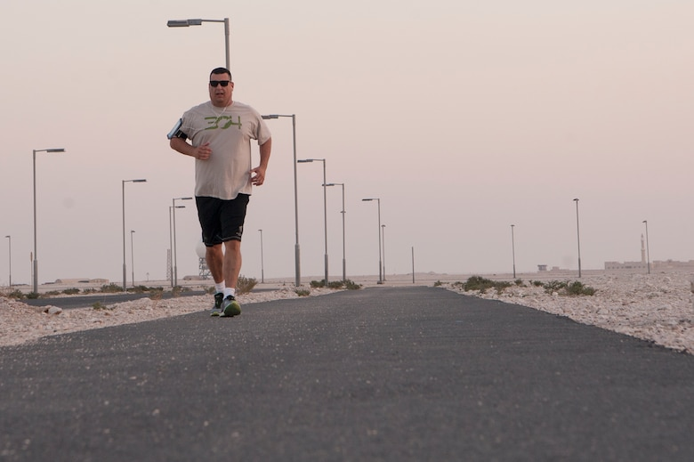 Chaplain (Maj.) Jack Miller, 379th Air Expeditionary Wing chapel office, runs the Blatchford-Preston Complex perimeter Dec. 6, 2018, at Al Udeid Air Base, Qatar. Miller was diagnosed with adrenal cancer in 2012 and told by doctors that he would never run longer distances again. While deployed at Al Udeid, Miller trained for months and was able to complete the base's Veterans Day 5K run Nov. 11, 2018. (U.S. Air Force photo by Tech. Sgt. Christopher Hubenthal)