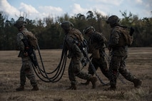 U.S. Marines assigned to Combat Logistics Battalion-6, complete de-rigging of a M777 Howitzer in support of external lift operations during Exercise Northern Steel on Camp Lejeune, N.C., Dec. 5, 2018. The exercise combines elements of the Marine Air-Ground Task Force to build combined combat power, ensuring maximized readiness for potential global contingencies. (U.S. Marine Corps photo by Cpl. Santino D. Martinez)