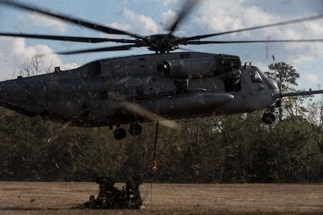A U.S. Marine Corps CH-53E Super Stallion aircraft assigned to Marine Heavy Helicopter Squadron 451 detaches a M777 Howitzer in support of external lift operations during Exercise Northern Steel on Camp Lejeune, N.C., Dec. 5, 2018. The exercise combines elements of the Marine Air-Ground Task Force to build combined combat power, ensuring maximized readiness for potential global contingencies. (U.S. Marine Corps photo by Cpl. Santino D. Martinez)