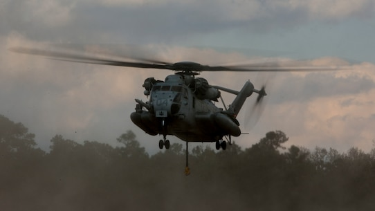 U.S. Marine Corps CH-53E Super Stallion aircraft assigned to Marine Heavy Helicopter Squadron 451 (HMH-451) conduct external lift operations during Exercise Northern Steel on Camp Lejeune, N.C., Dec. 5, 2018. The exercise combines elements of the Marine Air-Ground Task Force to build combined combat power, ensuring maximized readiness for potential global contingencies. (U.S. Marine Corps photo by Lance Cpl. Aaron Douds)