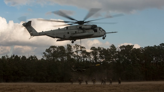 A U.S. Marine Corps CH-53E Super Stallion aircraft assigned to Marine Heavy Helicopter Squadron 451 conduct external lift operations during Exercise Northern Steel on Camp Lejeune, N.C., Dec. 5, 2018 The exercise uses multiple combative components in the division to enhance mission readiness. (U.S. Marine Corps photo by Lance Cpl. Aaron Douds)