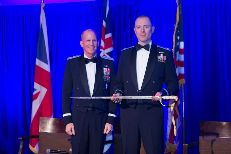 U.S. Air Force Gen. Stephen Wilson, Vice Chief of Staff U.S. Air Force, presents a sword to Lt. Col. Gwyddon Owen, 37th Intelligence Squadron commander, during the Royal Air Force Museum American Foundation (RAFMAF) Sword of Honour ceremony, Oct. 11, 2018. According to the RAFMAF, the award is presented to a Royal Air Force (RAF) and U.S. Air Force (USAF) Exchange Officer each year whose contributions have most reflected the values that honor the veterans and the Foundation share: service, excellence, integrity and courage. (Courtesy photo/Royal Air Force Museum American Foundation)