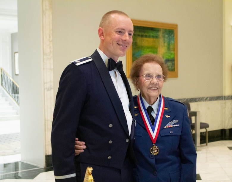 U.S. Air Force Lt. Col. Gwyddon Owen, 37th Intelligence Squadron commander, poses for a photo with Nell Bright, Women Airforce Service Pilot (WASP) WWII veteran, during the Royal Air Force Museum American Foundation (RAFMAF) 2018 Sword of Honour ceremony, Oct. 11. Owen, a cyberspace operations officer, a cyberspace operations officer, began working with the United Kingdom's Ministry of Defence (MOD), Defence Science and Technology Laboratories (DSTL) in May 2016, as a Military Advisor as part of the Military Personnel Exchange Program (MPEP) for Europe, Africa and the Middle East and was selected as the 2018 U.S. Sword of Honour recipient. (Courtesy photo/Royal Air Force Museum American Foundation)