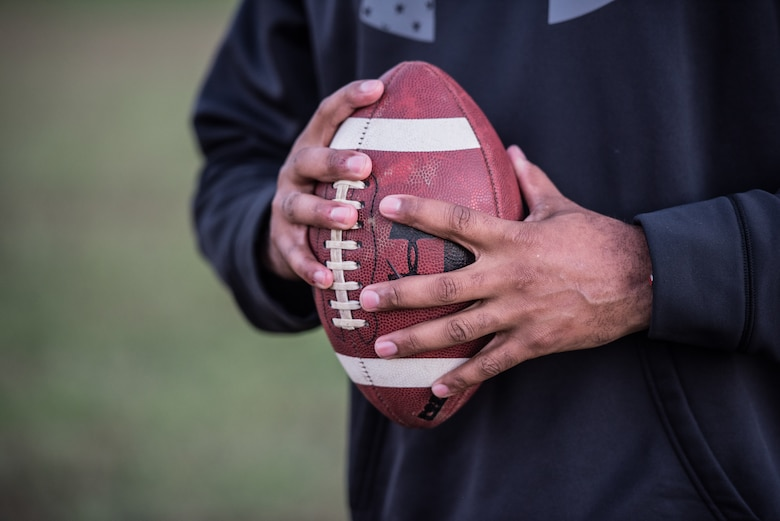 Chief Master Sgt. Anthony Harris, 512 Airlift Wing Force Support Squadron superintendent, holds a football in Dover Delaware, Oct. 18, 2018. Harris played football from a young child until his first year of college. (U.S. Air Force photo by Staff Sgt. Damien Taylor)