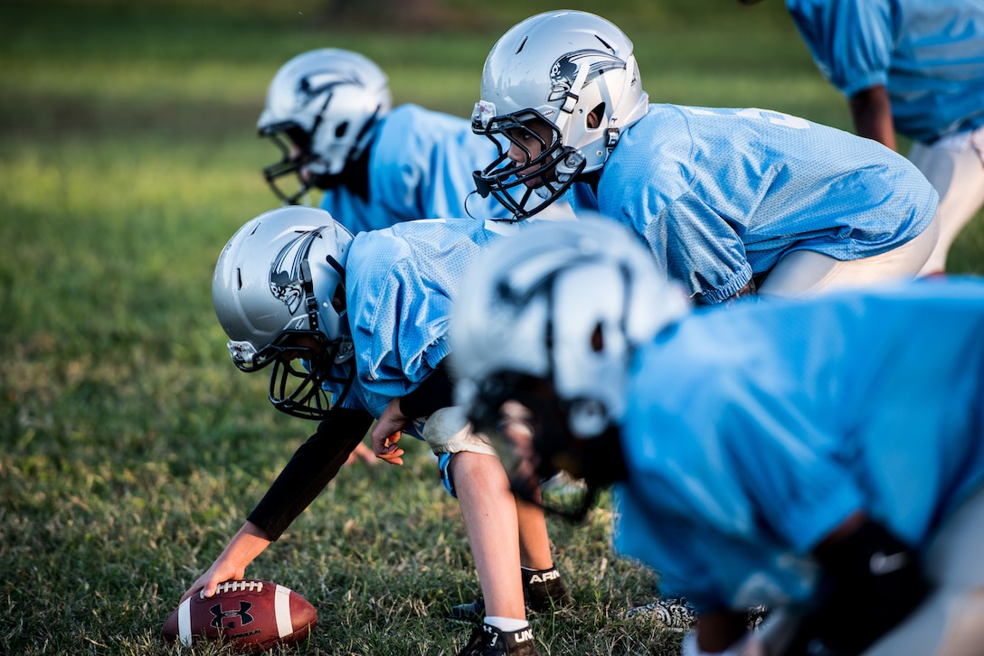 The Pop Warner Dover Caesar Rodney Raiders prepare to run a football play in Dover, Delaware, Oct. 18, 2018. The CR Raiders held practice every Thursday evening from 5:30 to 8 p.m. to prep Saturday games. (U.S. Air Force photo by Staff Sgt. Damien Taylor)