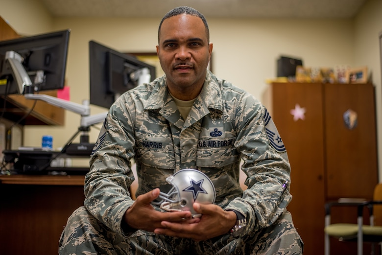Chief Master Sgt. Anthony Harris, 512 Airlift Wing Force Support Squadron superintendent, poses for a photo in his office at Dover Air Force Base, Delaware, Nov. 24, 2018. Harris played football until his first year of college, learning disciple and resilience that helps him execute the wing mission as a chief master sergeant. (U.S. Air Force photo by Staff Sgt. Damien Taylor)