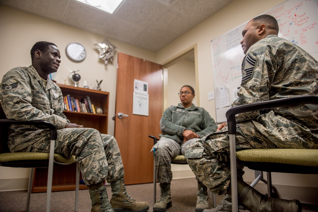 Chief Master Sgt. Anthony Harris, 512 Airlift Wing Force Support Squadron superintendent, holds a feedback session with Senior Airman Maboury Gueye and Staff Sgt. Tiffany McClammy, two FSS Airmen, at Dover Air Force Base Delaware, Nov. 24, 2018. Harris meets with lower ranking Airmen as a way to monitor service member morale. (U.S. Air Force photo by Staff Sgt. Damien Taylor)