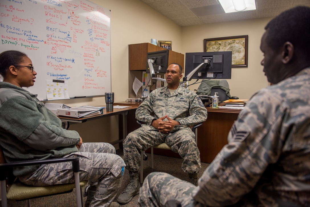 Chief Master Sgt. Anthony Harris, 512 Airlift Wing Force Support Squadron superintendent, holds a feedback session with Senior Airman Maboury Gueye and Staff Sgt. Tiffany McClammy, two FSS Airmen, at Dover Air Force Base Delaware, Nov. 24, 2018. Harris meets with lower ranking Airmen as a way to garner input for innovating wing processes. (U.S. Air Force photo by Staff Sgt. Damien Taylor)