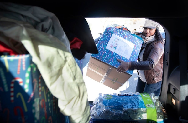 Master Sgt. Lan Archilla, 349th Civil Engineer Squadron first sergeant, transports 125 donated children's coats to the Coats for Kids drive at Travis Air Force Base, Calif., Dec. 6, 2018.