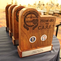 """U.S Air Force Airmen from Cannon Air Force Base, New Mexico, Fairchild Air Force Base, Washington, Offutt Air Force Base, Nebraska, and Al Dhafra Air Base, United Arab Emirates, received awards as part of the Trusted Care """"How Do You C.A.R.E."""" campaign, during the 2018 Air Force Medical Service Senior Leadership Workshop at the National Conference Center in Leesburg, Va., Dec. 5, 2018. (U.S. Air Force photo by Josh Mahler)"""
