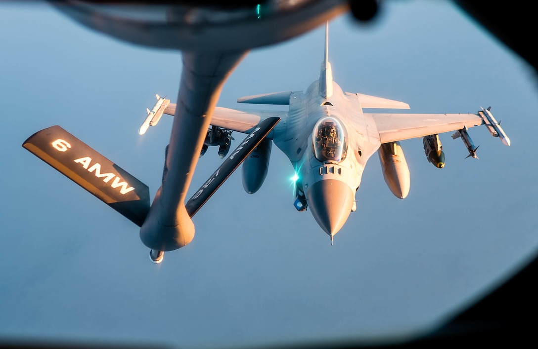 KC-135 Stratotanker refuels a U.S. Air Force F-16 Fighting Falcon