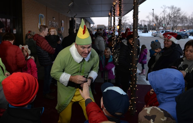 Senior Master Sgt. Charles Rose, 55th Wing Inspector General superintendent, entertains children as 'Budd' the elf during the annual Offutt Christmas Tree Lighting event held at the Patriot Club, Offutt Air Force Base, Nebraska, Dec. 6, 2018. Rose, along with being the festivities emcee, entertained guests throughout the club – always in character. (U.S. Air Force photo by Josh Plueger)