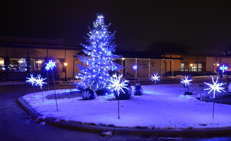 A tree used for the annual Offutt Christmas Tree Lighting ceremony, stands lit outside the Patriot Club on Offutt Air Force Base, Nebraska, Dec. 6, 2018. The 55th Force Support Squadron's tree lighting event was attended by an estimated 1,500 active-duty members and dependents. (U.S. Air Force photo by Josh Plueger)
