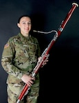Indiana National Guard Staff Sgt. LeeAnn Boaz, an instrumentalist with the 38th Infantry Division Band, poses with her bassoon on March 10, 2018.