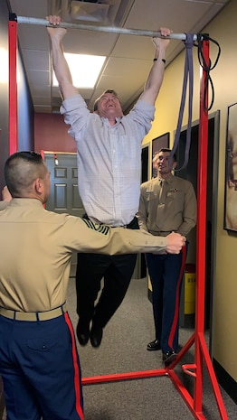 U.S. Senator Todd Young of Indiana, a U.S. Marine Corps veteran, conducts pull ups with Marines of Recruiting Station Indianapolis in Avon, Indiana, Dec. 7, 2018. Young represents Indiana in the U.S. Senate. Young was an officer selection officer with RS Indianapolis while active duty. (U.S. Marine Corps photo by Sgt. Carl King)