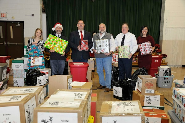 "Senior leaders and campaign coordinators take a moment to reflect on the generosity that provided the hundreds of items donated to support local families in need. Shown from left to right are and LeAnn Gaviglio, delivery and volunteer coordinator; Don Phillips, DLA Installation Support at Battle Creek site director; Kevin Faber, local DLA Information Operations ""mayor;"" Ray Zingaretti, Logistics Information Services director and Elli Blonde, who coordinated the collection efforts among the local Defense Logistics Agency activities."