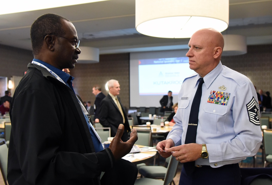 U.S. Air Force Chief Master Sgt. David Pizzuto, 81st Training Wing command chief, engages in discussion with Jeff Moore, SCORE certified mentor, during the Mississippi Gulf Coast Defense Forum inside the Courtyard by Marriott Gulfport Beachfront in Gulfport, Mississippi, Dec. 4, 2018. Over 130 people were in attendance over the two-day event, where participants gained a greater understanding of our military capabilities and opportunities in Mississippi. (U.S. Air Force photo by Kemberly Groue)