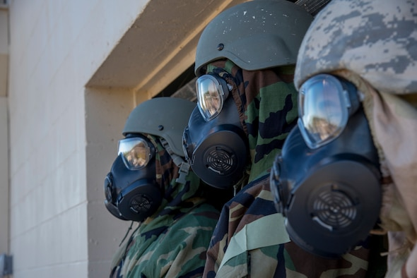 6th Mission Support Group Airmen don mission-oriented personal protective gear during an Ability to Survive and Operate training exercise at MacDill, Air Force Base, Fla., Dec. 6, 2018. This equipment protects the Airmen and allows them to continue operations and provide security in the event of a chemical attack.