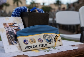 The ashes of a survivor are displayed during the Hickam Field Dec. 7th Remembrance Ceremony at Atterbury Circle, Joint Base Pearl Harbor-Hickam, Hawaii, Dec. 7, 2018. The ceremony included performances by the Air Force Band of the Pacific, laying commemorative wreaths, and an honor guard three-round volley. (U.S. Air Force photo by Tech. Sgt. Heather Redman)