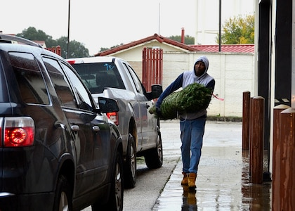 Staff Sgt. Mark Daniels, Assistant NCOIC, Palace Chase, Air Force Personnel Center, carries a Christmas tree as he volunteers to support Trees for Troops at Joint Base San Antonio-Randolph, Texas, Dec. 7, 2018. Since 2005, the organization has collected and donated over 176,000 trees for military families. FedEx has logged over 653,400 miles for this charity in the United States alone. They deliver the Christmas trees to 65 military bases, either in the U.S. or overseas.