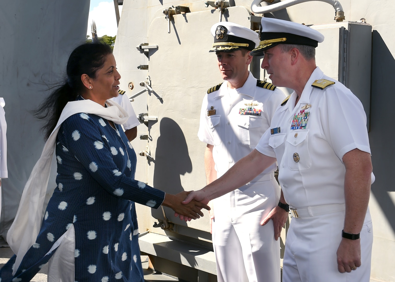 India's Defence Minister Nirmala Sitharaman is greeted by Rear Adm. Brian Fort, Commander, Navy Region Hawaii and Naval Surface Group Middle Pacific, before touring USS Michael Murphy (DDG 112). India and the U.S. are global partners in defense and security and are working together to assure a free and open Indo-Pacific.