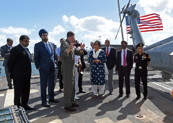 Cmdr. Daniel M. Martins, Executive Officer of the Easyriders Helicopter Maritime Strike Squadron Three Seven (HSM-37), briefs India's Minister of Defence, Nirmala Sitharaman during a tour abroad the USS Michael Murphy. India and the U.S. are global partners in defense and security and are working together to assure a free and open Indo-Pacific.