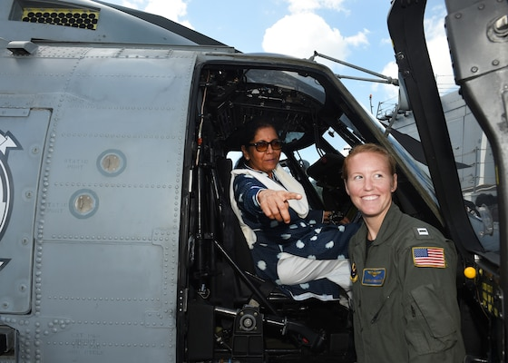 India's Minister of Defence, Nirmala Sitharaman sits inside of one of the Easyriders Helicopter Maritime Strike Squadron Three Seven (HSM-37) helicopters while touring the USS Michael Murphy. India and the U.S. are global partners in defense and security and are working together to assure a free and open Indo-Pacific.