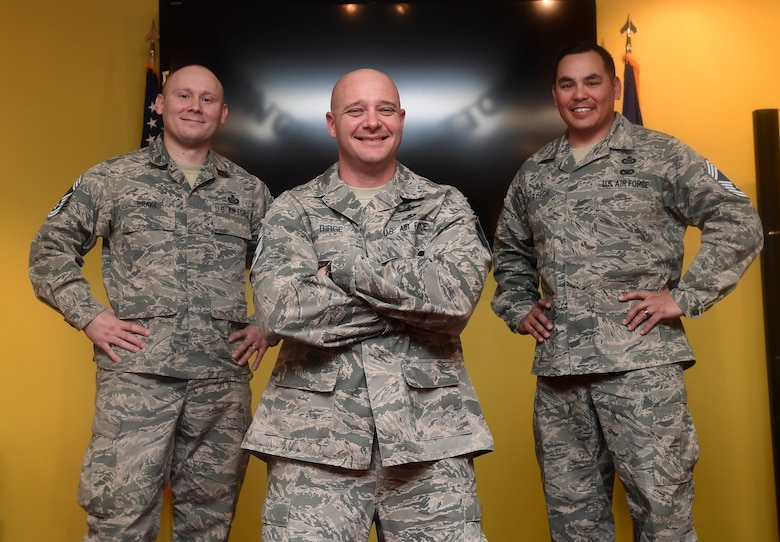 Senior Master Sgts. Joseph Drake, 460th Security Forces Squadron first sergeant, Dale Birge, 566th Intelligence Squadron information and intelligence analysis senior enlisted advisor, and Edward Sostack, Operations Division 7 superintendent, gather for a group photo at Buckley Air Force Base, Colo., Dec. 6, 2018.