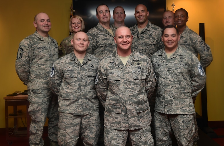 From left to right in front row, Senior Master Sgts. Joseph Drake, J. Dale Birge, and Edward Sostack, all chief master sergeant selects, stand among Team Buckley's chief master sergeants during the release party at Buckley Air Force Base, Colo., Dec. 6, 2018.