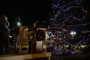 Family members of a deployed Airman from Columbus Air Force Base lit the tree during the Base Christmas Tree Lighting, Dec. 4, 2018, at the BLAZE Chapel here. After the lighting, children had the opportunity to have their photo taken with Santa in the Kaye Auditorium. (U.S. Air Force photo by Airman Hannah Bean)