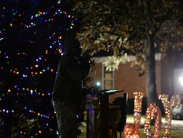 Chaplain (Capt.) Timme Henson, 14th Flying Training wing chaplain, introduces the 14th FTW commander and welcomes Team BLAZE during the base tree lighting Dec. 4, 2018, on Columbus Air Force Base, Mississippi. Team BLAZE lit the tree and the third light of the base menorah to begin the holiday season. (U.S. Air Force photo by Airman Hannah Bean)