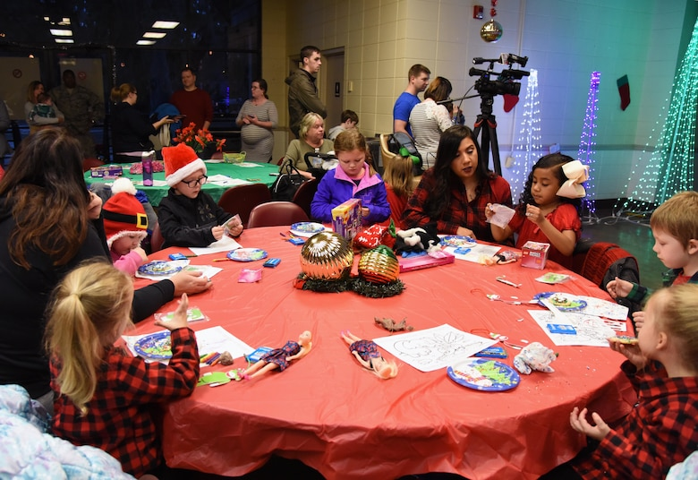 Keesler personnel attends Christmas in the Park at Keesler Air Force Base, Mississippi, Dec. 6, 2018. The event hosted by Outdoor Recreation included cookie and ornament decorating, games and visits with Santa. (U.S. Air Force photo by Kemberly Groue)