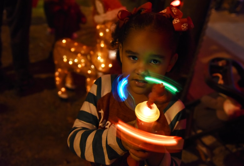 Avery Davis, granddaughter of U.S. Air Force Retired Master Sgt. Chad Jacob, plays with a light toy during Christmas in the Park at Keesler Air Force Base, Mississippi, Dec. 6, 2018. The event hosted by Outdoor Recreation included cookie and ornament decorating, games and visits with Santa. (U.S. Air Force photo by Kemberly Groue)