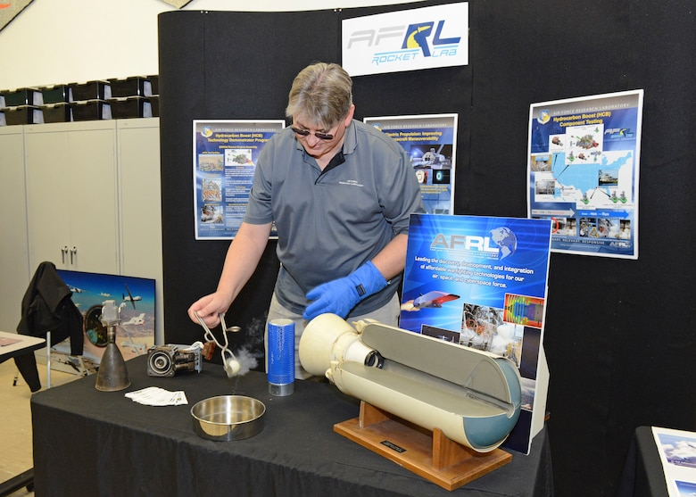 Kriss Vanderhyde, Air Force Research Labaratory Det. 7 Education Outreach manager, provides a simple propulsion demonstration following the grand opening of STARBASE at Branch Elementary on Edwards Air Force Base Dec. 7. The Department of the Defense STARBASE program aims at giving students a hands-on learning experience in the science, technology, engineering and mathematics fields. (U.S. Air Force photo by Kenji Thuloweit)
