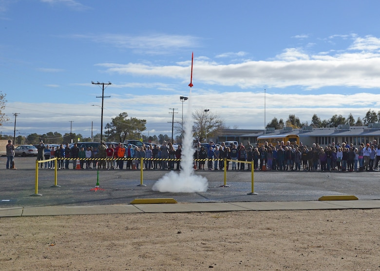 Students and guests at Branch Elementary on Edwards Air Force Base, California, watch a rocket take off as part of the grand opening of the base's new STARBASE school program Dec. 7. The program is aimed at giving students a hands-on learning experience in the science, technology, engineering and mathematics fields. (U.S. Air Force photo by Kenji Thuloweit)