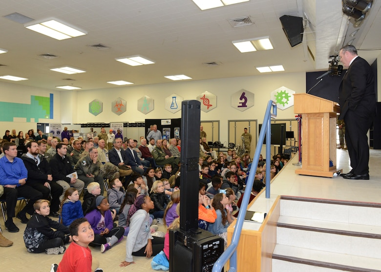 Mike O'Toole of the Department of Defense STARBASE program (right) addresses students and guests at the new STARBASE building at Branch Elementary at Edwards Air Force Base Dec. 7. The base held a grand opening for the educational program aimed at giving students a hands-on learning experience in the science, technology, engineering and mathematics fields. (U.S. Air Force photo by Kenji Thuloweit)