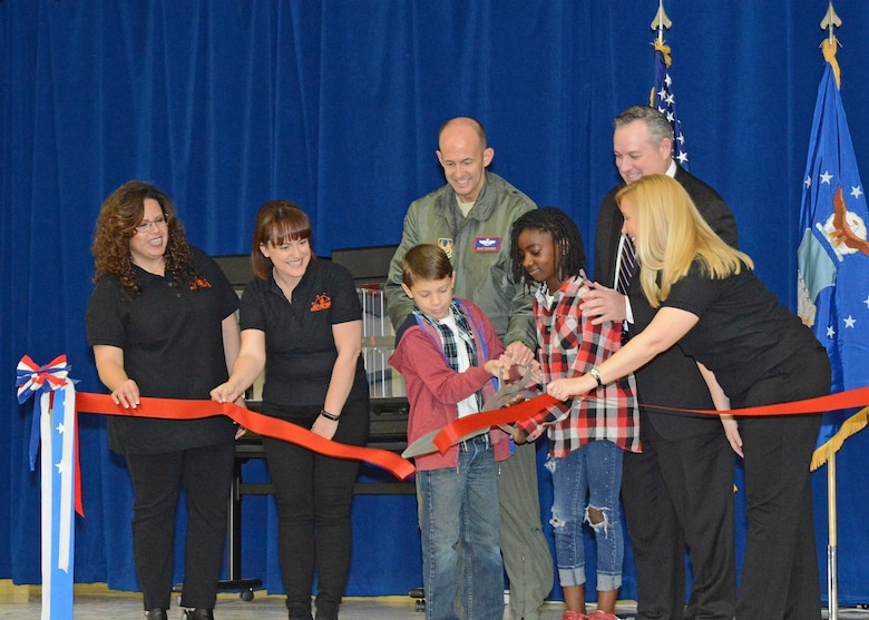 Members of the new STARBASE staff wearing the black shirts (left to right): Lourdes Talamantez, Caitlin Craig and Janet Creech, join fifth grade students Ananda and William, along with Brig. Gen. E. John Teichert, 412th Test Wing commander (center back), and Mike O'Toole, Department of Defense STARBASE program, in the ceremonial ribbon cutting to officially open STARBASE at Branch Elementary on Edwards Air Force Base. (U.S. Air Force photo by Kenji Thuloweit)