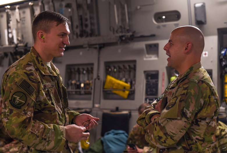 Capt. Jammie Bigbey, 627th Air Base Group chaplain, speaks with Capt. Jade Crain, 7th Airlift Squadron pilot, at Rota Naval Station, Nov. 28, 2018. Bigbey was part of a religious support team who provided assistance to deploying and returning Airmen for a three-month deployment at Ali Al Salem Air Base, Kuwait, and Al Udeid Air Base, Qatar.  (U.S. Air Force photo by Senior Airman Tryphena Mayhugh)