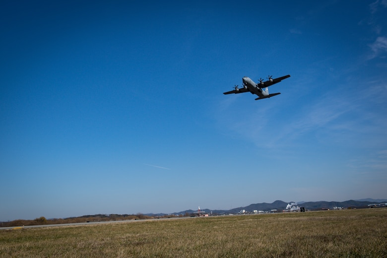 A C-130J Super Hercules departs Osan Air Base, Republic of Korea, transporting a Balangiga Bell to Kadena Air Base, Japan, Dec. 7, 2018. The 51st Logistics Readiness Squadron was called on by Pacific Air Forces to create a special airlift mission to support the U.S. Army's shipment of the bell. (U.S. Air Force photo by Staff Sgt. Benjamin Raughton)
