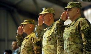 Three American military men salute.