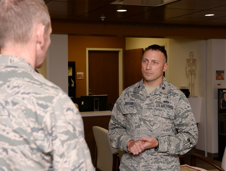 Maj. Christopher J. Button, commander of the 509th Medical Group mental health flight, briefs Maj. Gen. James C. Dawkins Jr.