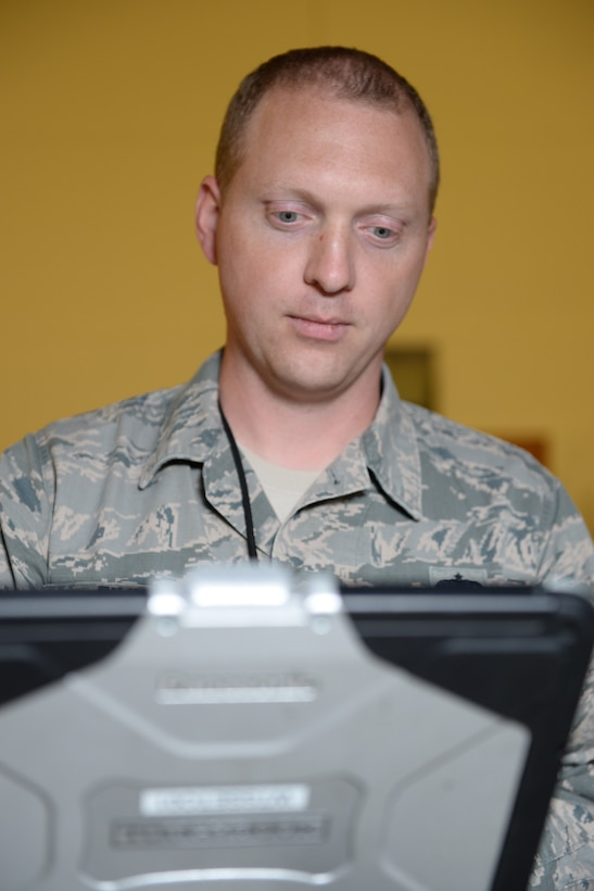 Staff Sgt. James B. Finn, a signature diagnostics technician assigned to the 509th Bomb Wing, processes the results of his inspection of a B-2 Stealth Bomber.