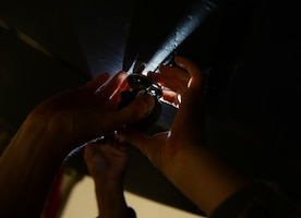 Staff Sgt. James B. Finn, a signature diagnostics technician assigned to the 509th Bomb Wing, uses a step height gauge during an inspection of a B-2 Stealth Bomber.