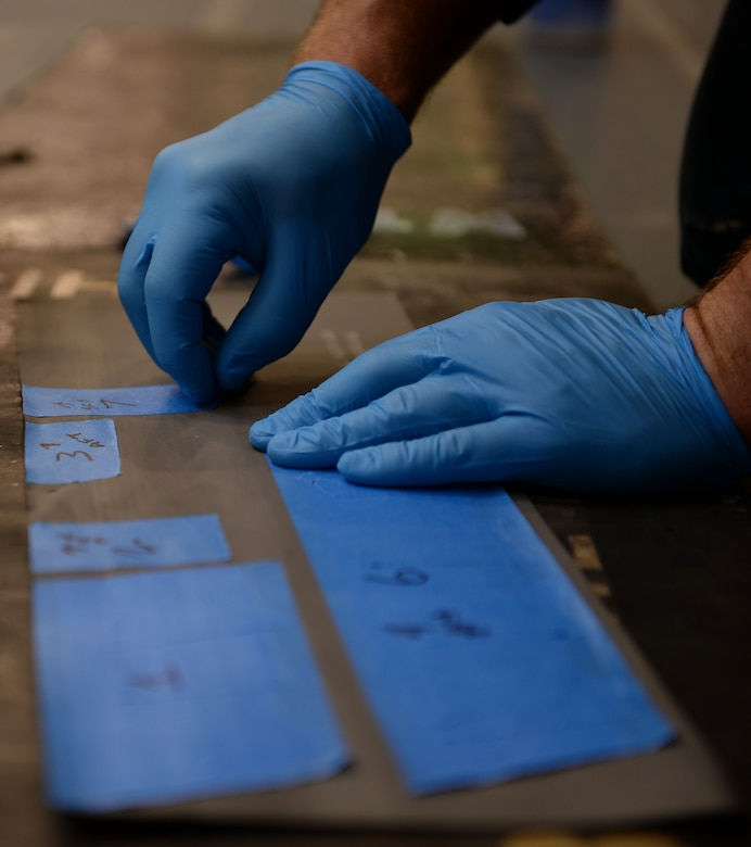 Staff Sgt. Josh Batschke, a low-observable maintenance craftsman assigned to the 131st Maintenance Squadron, Missouri Air National Guard, prepares maintenance labels.