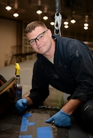 Staff Sgt. Josh Batschke, a low-observable maintenance craftsman assigned to the 131st Maintenance Squadron, Missouri Air National Guard, poses for a portrait.