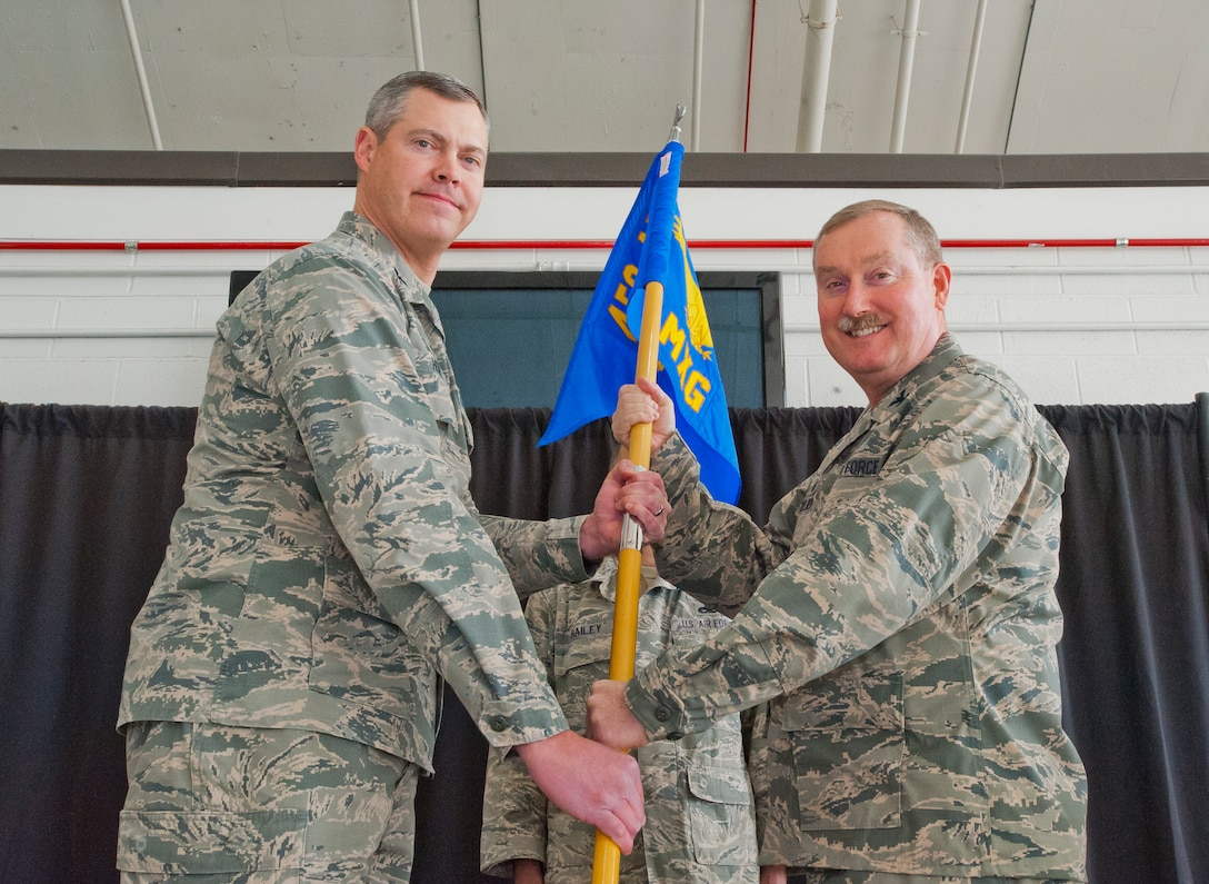 Col. Douglas E. Gullion, commander of the 459th Air Refueling Wing, passes the guidon to Col. Christopher J. Hobbs, commander of the 459th Maintenance Group, during a change of command ceremony at Joint Base Andrews, Maryland, Dec. 8, 2018. Hobbs assumes command of the 459th MXG from the Secretary of the Air Force's Office of the Inspector General at the Pentagon where he served as a Senior Officials Inquiries Officer. (U.S. Air Force photo by SrA Andreaa Phillips)