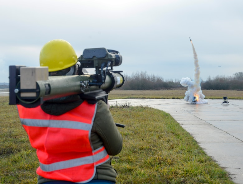 A Polygone employee uses a man-portable aircraft survivability trainer, or MAST, and a smoky surface-to-air missile to simulate enemy fire for the aircrew of a C-130J Super Hercules aircraft assigned to the 37th Airlift Squadron, 86th Airlift Wing, Ramstein Air Base, Germany, during exercise Contested Forge on Grostenquin Air Base, France, Dec. 4, 2018. Contested Forge is an annual exercise that tests the 435th Contingency Response Group's ability to build a forward operating base and conduct airfield operations in an austere environment, friendly or hostile. (U.S. Air Force photo by Staff Sgt. Timothy Moore)