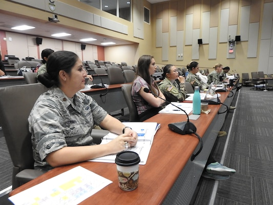 U.S. Air Force Maj. Monica Herrera facilitates students on how to integrate gender into military operations during the Operational Gender Advisor Course hosted by U.S. Southern Command in Doral, Florida, Dec. 6, 2018.